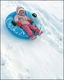 Girl sledging. Pic: Claire McKenzie