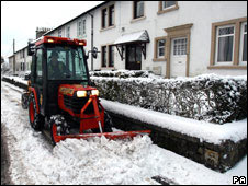 A tractor clearing snow