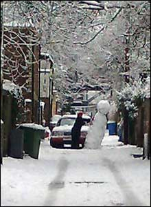 A frustrated driver tries to clear an 8ft snowman from the lane at the back of houses off Great western Road in Glasgow. taken by Dave Beaven.