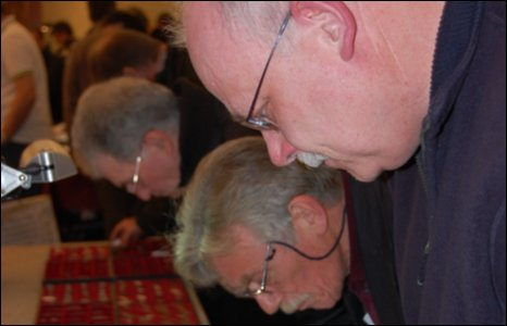 Visitors study coins at the Midland Coin Fair
