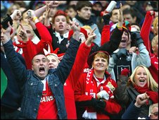 Welsh fans celebrate a Six Nations victory