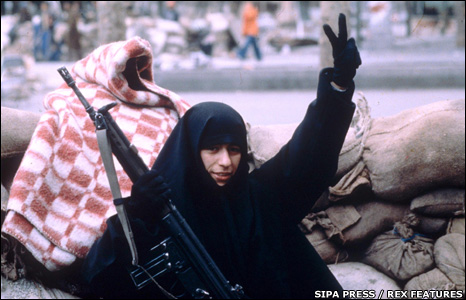 A female student takes part in the revolution of 1979