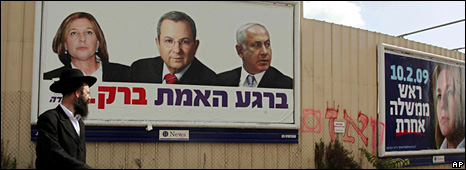 Man walks past Israeli election poster for Labour Party (29 January 2009)