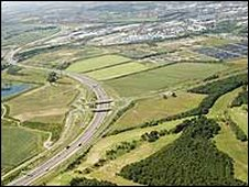 Aerial picture of motorway junction and adjacent land