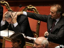 Health Minister Maurizio Sacconi is comforted by European Affairs Minister Andrea Ronchi at the announcement of the death of Eluana Englaro