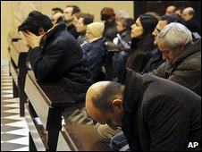 Worshippers kneel in prayer inside the Basilica of San Nicolo in Lecco, northern Italy, after the announcement of the death of Eluana Englaro