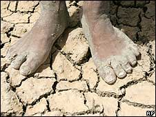 Boy's feet on baked soil (Image: AP)