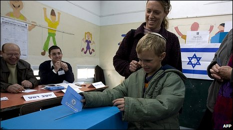 Boy casts his mother's vote in Jerusalem
