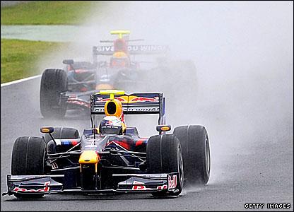 Toro Rosso's Sebastien Buemi in front of Red Bull's Sebastian Vettel