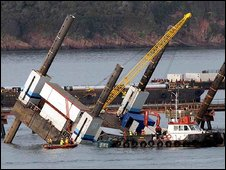 A maintenance barge collapses