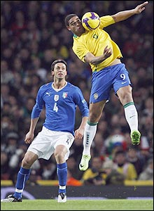 Adriano controls a difficult ball as Nicola Legrottaglie watches on