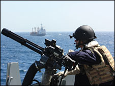 Royal Navy lookout escorting food ship off Somalia, 2009
