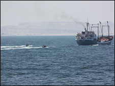 Royal Navy boats escorting food ship into Bossasso, Somalia