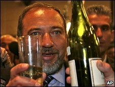 Avigdor Lieberman, head of the Yisrael Beitenu party, raises a toast at the party's Jerusalem headquarters, 11 February 2009