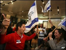 Supporters of the Yisrael Beitenu party celebrate as exit polls are announced  in Jerusalem, 10 February 2009