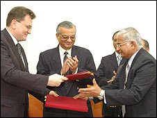 Officials sign the deal in Mumbai