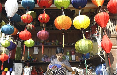 A man makes a lantern at a shop in the Vietnamese city of Hoi An