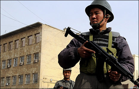 Afghan policeman outside the Justice Ministry