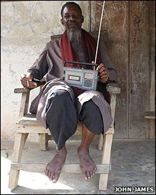 Village chief Aladji Mohamed Saradogo listening to the radio