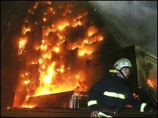 Firefighters try to put out the fire at the unfinished Mandarin Hotel in Beijing