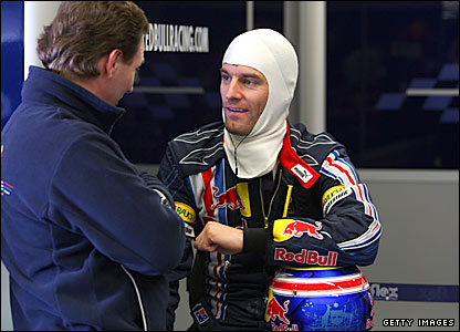 Red Bull Christian Horner (left) speaks to Mark Webber