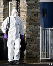 Forensics expert at murder scene