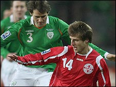 Kevin Kilbane of the Republic of Ireland competes with Georgia's Beka Gotsiridze