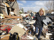 Resident Karen Arms in the remains of her home in Edmond, Oklahoma