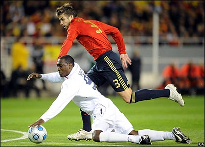 Gerard Pique hauls England's Emile Heskey down on the edge of the box