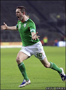 Keane celebrates scoring the winner