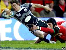 Max Evans scores against Wales