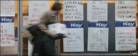Man walks past job adverts