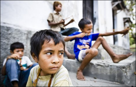 Children with catapults in Liquica, East Timor