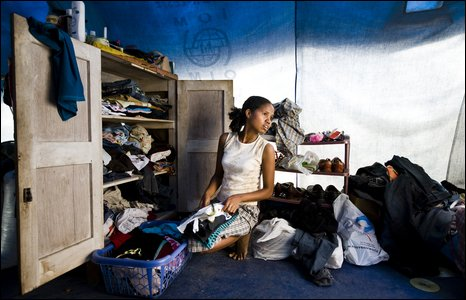 Elsa Araujo Pinto sorts through her washing at the make-shift family home in one of Dili's camps for internally displaced people.