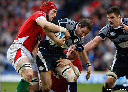 Graeme Morrison of Scotland is tackled by Alun Wyn Jones during the Six Nations clash at Murrayfield