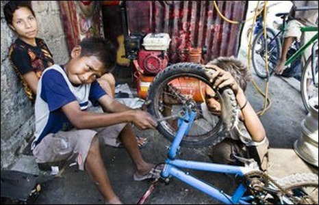 Young boys run a bicycle repair shop on the streets of the East Timorese capital, Dili.