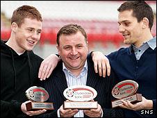 James McCarthy, Billy Reid and Tomas Cerny show off their awards
