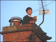 Child reading on the roof