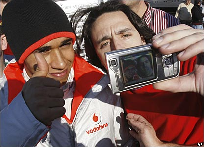 Jerez, Spain, 12 February: Lewis Hamilton takes time out from testing the new McLaren to pose for photos with fans