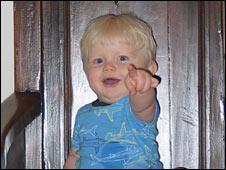 A toddler points with a finger