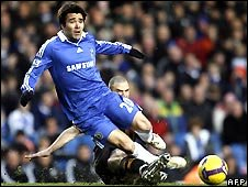 Chelsea midfield player Deco is tackled