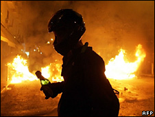 Protester holding a petrol bomb during riots in Athens (8 December 2008)