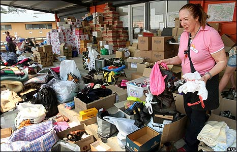 Volunteers sort through tonnes of donated goods at the Whittlesea relief centre