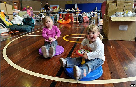 Imogen and Mya Roberts, of Kinglake, play among a sea of donated goods