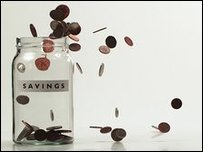 "A jar labelled ""savings"" with money falling into it"