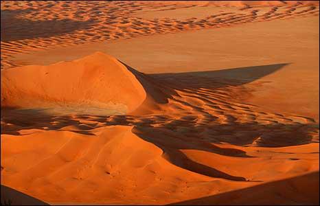 Shadows grow as the sun drops in Oman