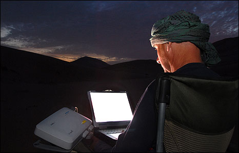 Using a laptop in the desert