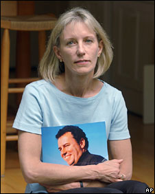 Beverly Eckert, photographed holding a picture of her husband in May 2002