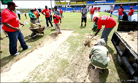 Groundstaff treat the pitch