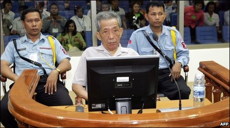 "Kaing Guek Eav better known as ""Duch"" (C) sits in a dock in the court room at the Extraodinary Chambers in the Courts of Cambodia in Phnom Penh on December 5, 2008"